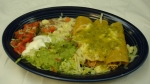 Enchiladas Suizas - Three chicken enchiladas topped with green sauce and served with beans and salad.